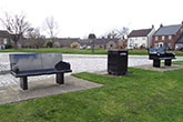 Black granite park benches and litter bin - West Cornforth Green, Co. Durham