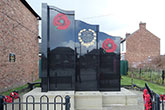 Black granite and Yorkstone war memorial - Chilton town centre memorial garden