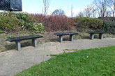 Park benches in contrasting black granite finishes - Spennymoor town centre, Co. Durham
